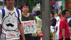 Man Protest Nuclear Weapons On The Streets Of Shinjuku Tokyo Stock Footage