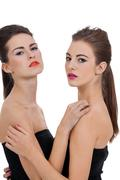 Two beautiful girls with colorfull makeup isolated Stock Photos