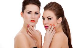 Stock Photo of two beautiful girls with colorfull makeup isolated
