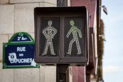 Pedestrian traffic lights at an intersection - stock photo