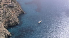 AERIAL Spain-Yacht Off Punta Rosa Coast Stock Footage