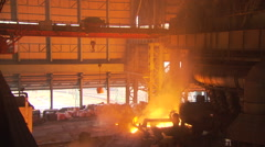Steel Mill  crane moves overhead Stock Footage