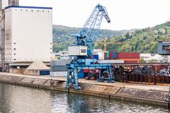 Shipyard with containers and cranes - stock photo