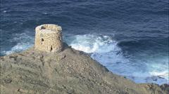 AERIAL Spain-Coastal Defence Tower Stock Footage
