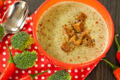 Bowl of chili pepper and broccoli soup Stock Photos