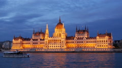 The Hungarian Parliament Building in the evening at the Danube river Stock Footage