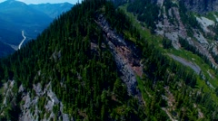 A summer view of a rocky, green alpine mountain Stock Footage