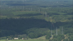 Stock Video Footage of AERIAL France-Pylons lined up over wood