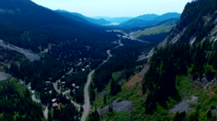 A road in a valley between mountains Stock Footage