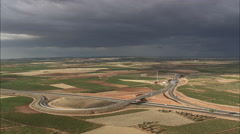 AERIAL Spain-Field Patterns With Storm Clouds Ahead Stock Footage