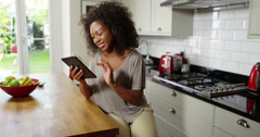 An attractive woman does her online shopping on her digital tablet Stock Footage