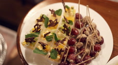 Portion dessert with fruit and grape on a stick in the catering Stock Footage