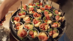 Salad from vegetables, greens and sturgeon in small portions on catering Stock Footage