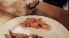 The waiter puts  smoked salmon on the plate and cut into cubes Stock Footage