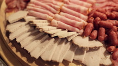 Meat cutting from boiled pork, sausages, smoked meat, sturgeon on catering Stock Footage
