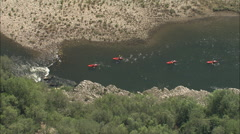 AERIAL France-Canoes Passing Rapids In Ardeche Gorge - stock footage
