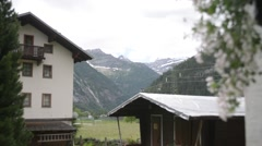 The small alpine town in summer Stock Footage