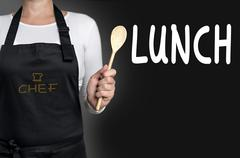 Lunch cook holding wooden spoon background - stock photo