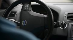 A man drives Volvo, turn the steering wheel of a vehicle - stock footage