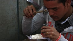 Tibetan man making souvenirs from metal. Leh, Ladakh, India Stock Footage