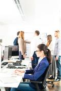 Working in a modern office Kuvituskuvat
