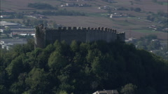 AERIAL Italy-Flight Past Old Castle On Mountain Top Stock Footage