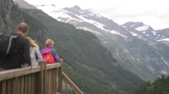 In the Alps, tourists admire the mountain peaks Stock Footage