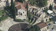 Stock Video Footage of AERIAL Italy-Roman Amphitheatre By River
