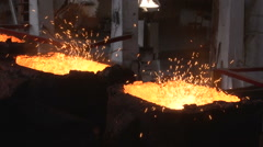Molten iron in forms Stock Footage
