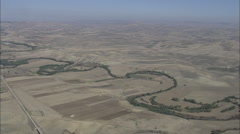 AERIAL Italy-River Running Through Parched Landscaped Stock Footage