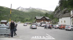 The restaurant and parking near the waterfall Cascata del Toce in the Alps Stock Footage