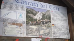 Information stand at the waterfall Cascata del Toce in the Alps Stock Footage