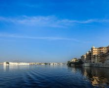 Romantic India luxury tourism concept background - Udaipur City Palace, Lake  - stock photo
