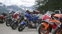 Cool bikes on the background of snow-capped Alps Stock Footage