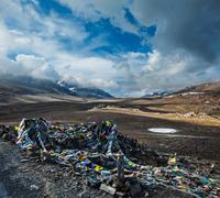 Buddhist prayer flags (lungta) on Baralacha La pass on Manali-Leh highway in  - stock photo