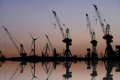 Harbor cranes at dawn harbor Hamburg Germany Europe Stock Photos