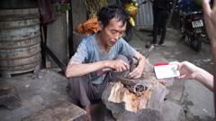 Karen man making handicraft by hammering down stainless steel Stock Footage