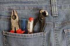 Pliers and screwdrivers in a back pocket DIY Stock Photos