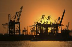Gantry cranes harbour cranes container terminal sunset port Hamburg Germany - stock photo