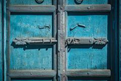 Latch with padlock on door in India - stock photo