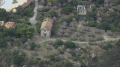 AERIAL Italy-Hotel Surrounded By Small Huts Stock Footage