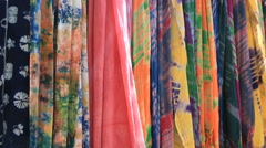 Stock Video Footage of Tie dyeing art fabrics swaying in wind at Zhoucheng village in Dali, China