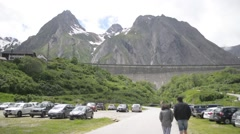 Parking auto on the background of snow-capped Alps Stock Footage
