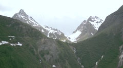 Alps in summer. Snow-covered peaks and green grass Stock Footage