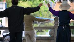 Chinese people dancing together at Green Lake Park in Kunming Stock Footage