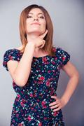 Woman showing threatening gesture - stock photo