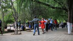 Senior couples dancing at Green Lake Park in Kunming Stock Footage