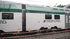 Train Trenord in Milan, departs from the station Stock Footage