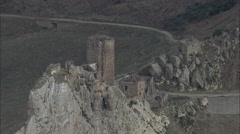 AERIAL Italy-Ruined Fort On Rocky Outcrop Stock Footage