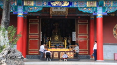 People worshipping at Yuantong Temple in Kunming, China Stock Footage